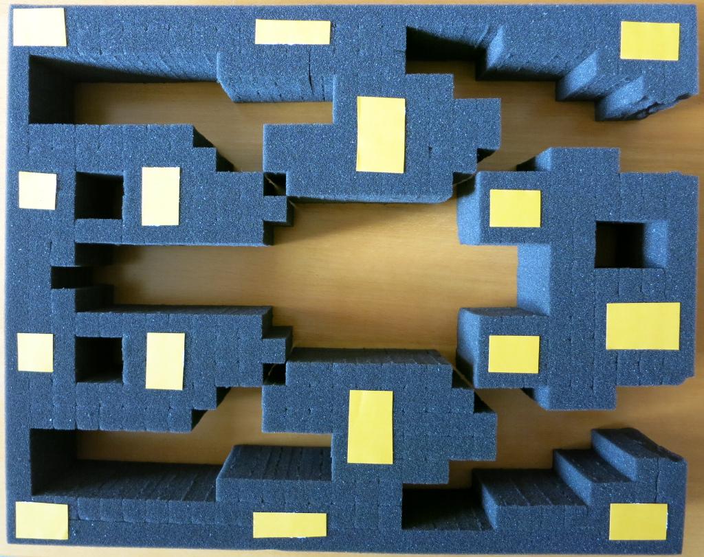 Schaumstoff mit doppleseitigem Klebeband fixieren